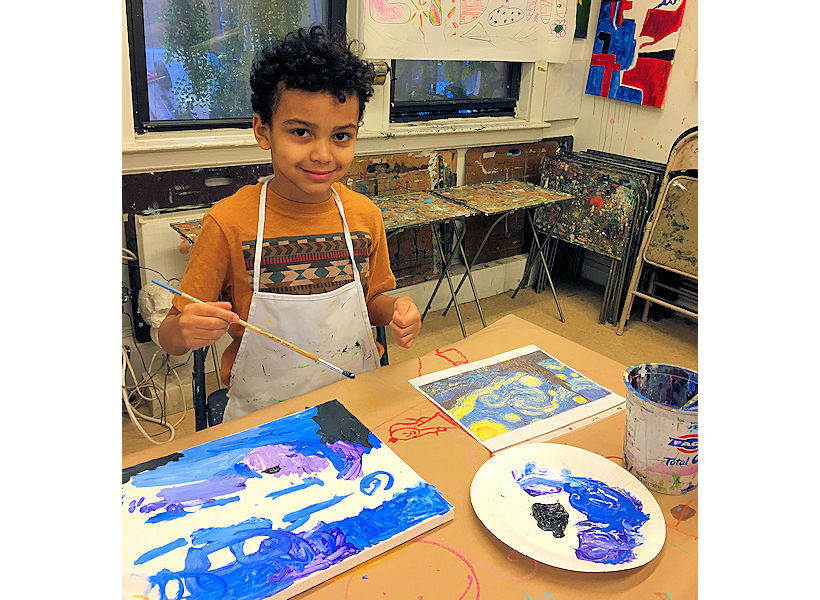 child painting on canvas in progress inspired by Van Gogh's Starry Night during kids art birthday party with fun art instructors in nyc art studio