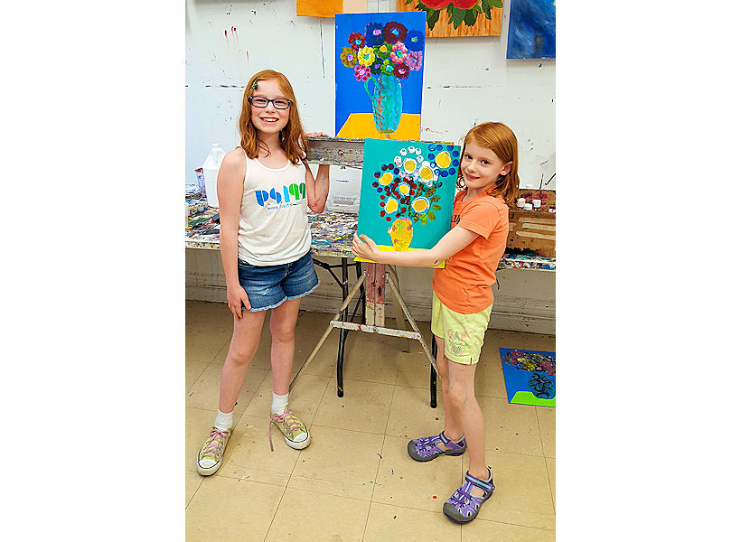 happy girls showing their Van Gogh-inspired mixed media paintings on canvas created in kids art classes creativity for children nyc uws