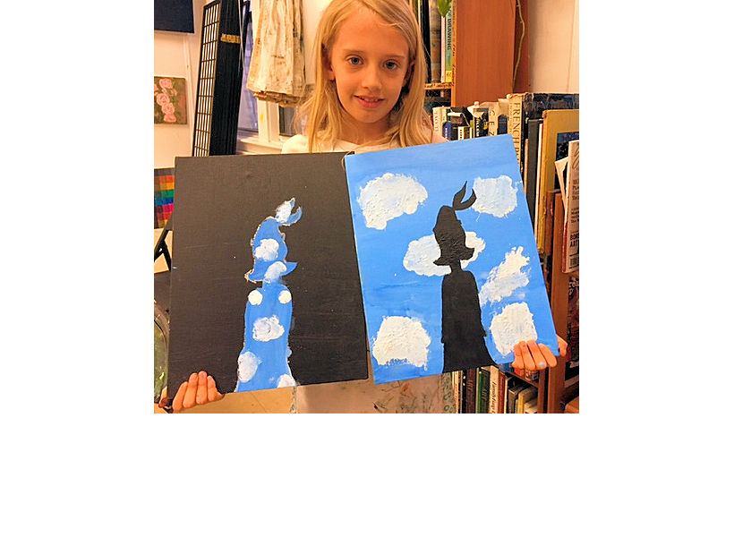 happy girl sharing her paintings on canvas from her kids art class at the art studio ny in nyc with inspiring art instructors