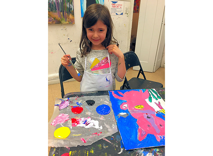 joyful child artist in her kids art class for kids with her animal painting on canvas with enthusiastic art instructor Sophia Spector at the art studio ny on the uws art studio