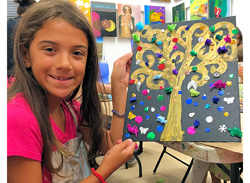 happy 8-year-old artist showing her Klimt inspired mixed media painting on canvas in her children's painting class at the art studio ny nyc uws
