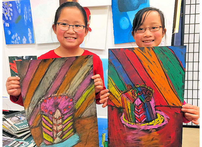 happy kids 2nd grade in art class at the art studio ny uws nyc showing pastel drawings inspired by Wayne Thiebaud they created with nurturing instructor at the Tuesday after school class