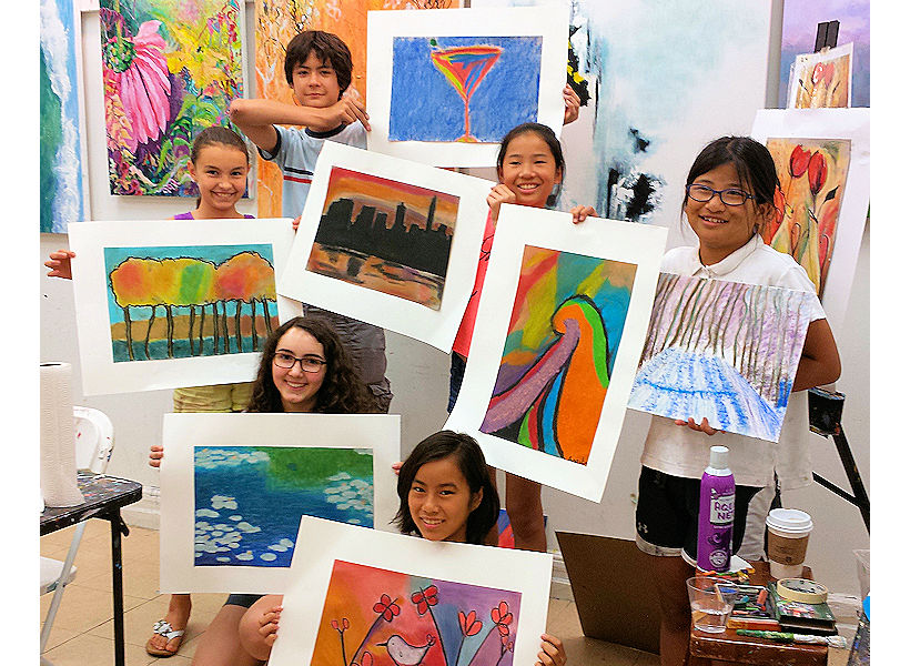 proud teens sharing their pastel paintings during teen art class and teen art camp in nyc uws the art studio ny